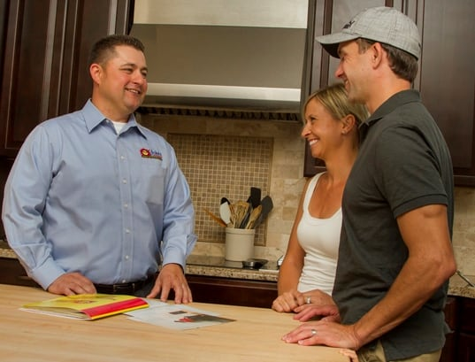Couple discussing HVAC purchase