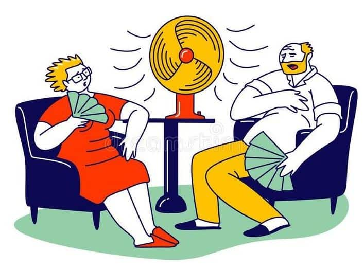 couple sitting in hot room with fan
